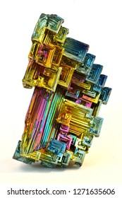 MUSEUM MINERAL SERIES: bismuth crystals. Bismuth is the most strongly diamagnetic element and also the heaviest that is not radioactive. White background.