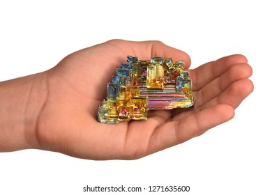 MUSEUM MINERAL SERIES: large bismuth specimen and hand. Bismuth is the most strongly diamagnetic element and also the heaviest that is not radioactive. White background.