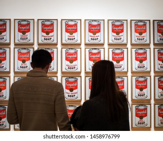 Museum of Modern Art, or MoMA, Manhattan, New York, United States of America - Jan 23 2015: Campbell's Soup Cans, the artwork by Andy Warhol. Leading figure in pop art. Famous work. Visitors watching.