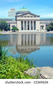 Museum of Science and Industry in Chicago reflected in the water.