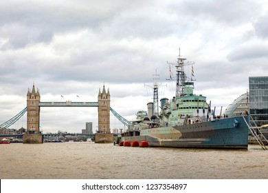 Museum ship and Tower Bridge on the river Thames in London