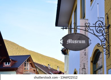 Museum sign in Oberammergau with mountains in the backround