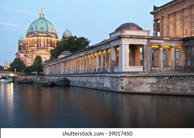 Museumsinsel in Berlin with Alte Nationalgalerie and Berliner Dom. River Spree in foreground.