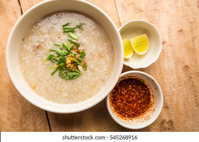 Mush or Boiled rice pork for Thai style,,on wood background