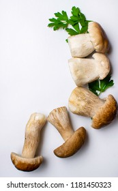 Mushroom Boletus over white Background with parsley. Autumn Cep Mushrooms. Ceps Boletus edulis, close up Cooking delicious organic mushroom. Gourmet food