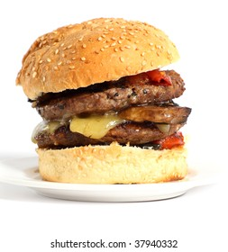 A mushroom burger, with fried tomatoes and cheddar cheese