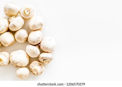 Mushroom champignons. Fresh raw whole champignons on white background top view copy space