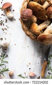 Mushroom cooking  recipe background;  organic porcini ; seasoning forest Mushroom and Italian Spices Herb