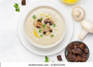 Mushroom cream soup with cream, croutons of dark bread, olive oil, delicious healthy food