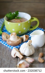 Mushroom cream soup with mushrooms, garlic and sour cream on the table