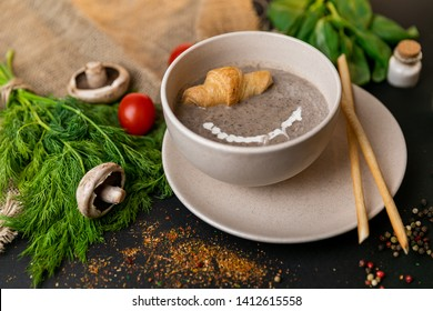 mushroom cream soup on white wooden board. top view. Healthy food, top view. Black background . Slow-mo