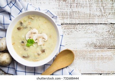 mushroom cream soup on white wooden board. top view