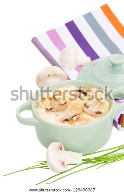 mushroom julienne vegetarian casserole isolated on white background
