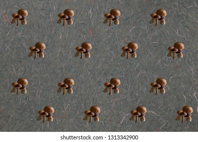 Mushroom pattern on a thready gray paper background. Hipster. contemporary composition. Fun.
