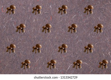 Mushroom pattern on a thready pink paper background. Hipster. contemporary composition. Fun.