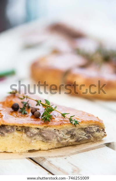 Mushroom pie piece close up on a rustic background