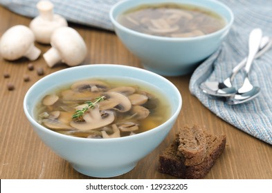 Mushroom soup in a blue bowl on a wooden table