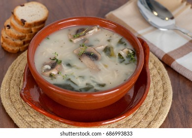 Mushroom soup with chicken meat on wooden background