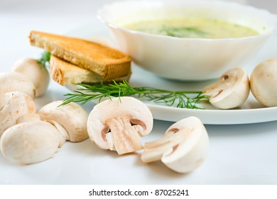 mushroom soup with dill, toasts and field mushrooms. Focus on a foreground.