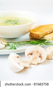 mushroom soup with dill, toasts and field mushrooms.Focus on a foreground.