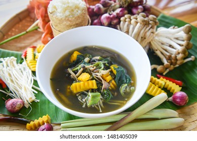 Mushroom soup herbs and spices ingredients Thai food served on bowl / Mix various kinds of mushrooms tradition northeast food Isaan delicious with vegetables pumpkin - Thai menu Asian food