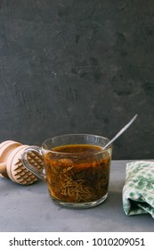 Mushroom soup with noodles in a glass cup