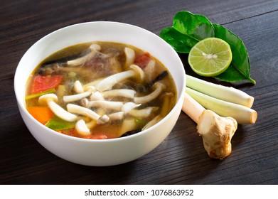 Mushroom soup (Thai called Tom Yum Hed) Thai food in white bowl, Select focus