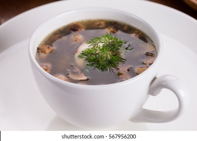 Mushroom soup in white bowl. Close-up view.