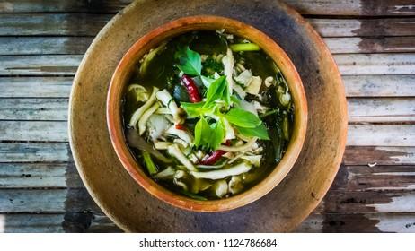 Mushroom spicy soup in earthen bowl.