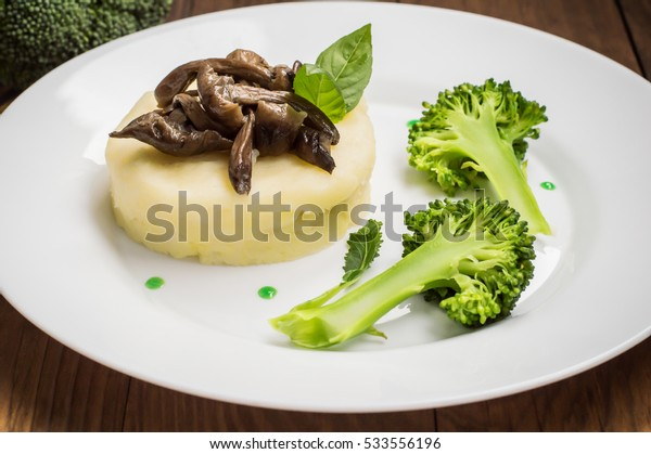 mushroom stroganoff, a hearty gravy with farm fresh potatoes and broccoli