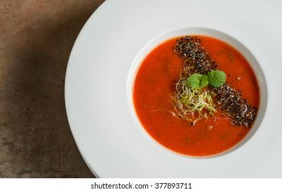 Mushrooms cream soup on granite board
