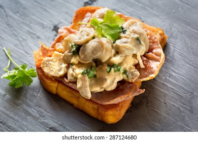 Mushrooms in a creme freche sauce on a bed of fried Prosciutto and bruschetta