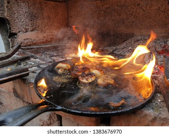 mushrooms in a frying pan on fire