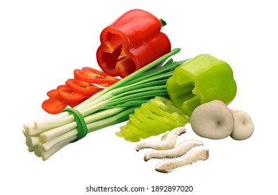 mushrooms, green onions and two fresh red and green bell peppers, cut into rings on a white isolated background