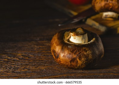 Mushrooms lying on a wooden table