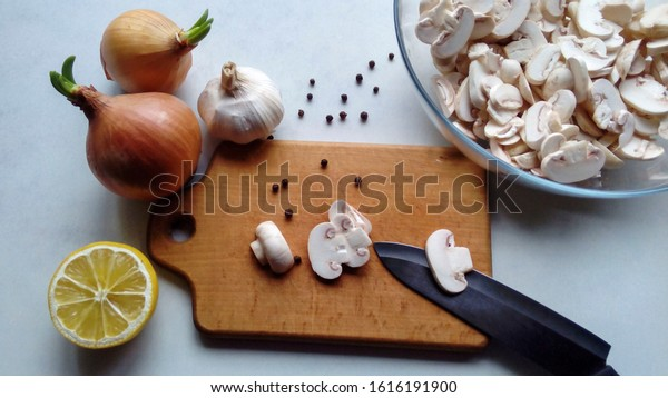Mushrooms on a wooden board on the table