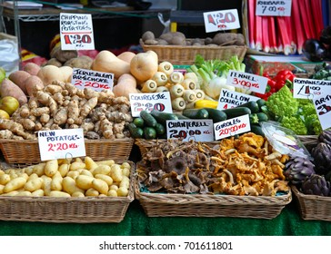 Mushrooms and vegetables at farmers market stall