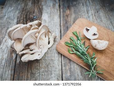 Mushrooms/Pleurotus ostreatus on a wooden background