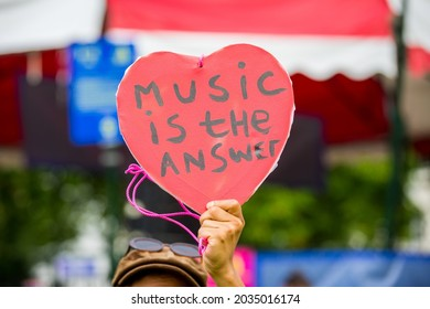 Music is the answer sign during protest in a park