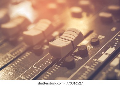 Music audio system concept in vintage style. Sound mixer buttons control with black and white sound mixer buttons in recording room . Selective focus.