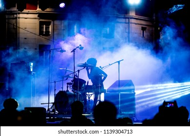 Music band in concert. Stage lights color.