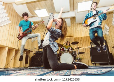 Music band having fun performing on a stage