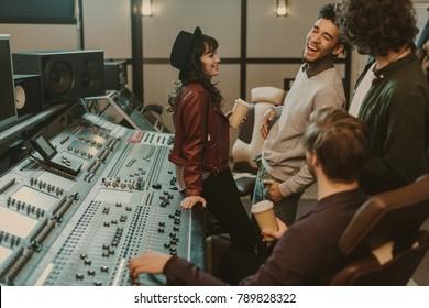 music band having fun at sound recording studio