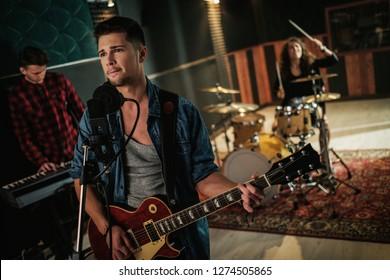 Music band having rehearsal