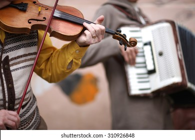 Music band performance; hands of violoncellist in focus