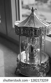 music box carousel on the window sill of a child's room waiting to be turn watch and herd.