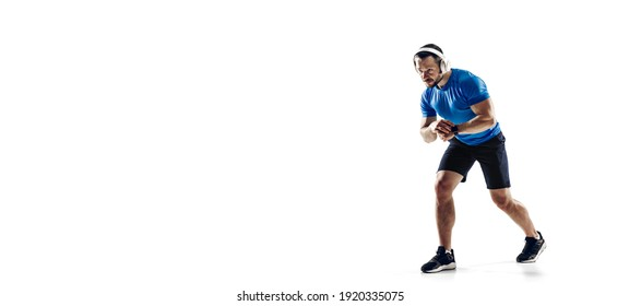 Music. Caucasian professional male athlete, runner training isolated on white studio background. Muscular, sportive man. Concept of action, motion, youth, healthy lifestyle. Copyspace for ad. Flyer