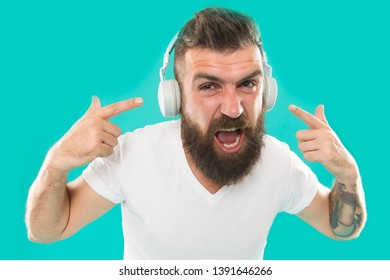 Music chart. Hipster with beard listening music. Handsome music lover. Man in headphones. Streaming sites which we believe are hippest and hottest around. Free online music sources different features.