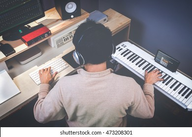 music composer making songs in recording studio