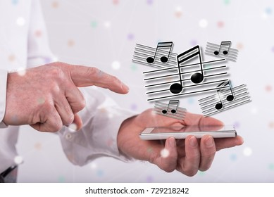 Music concept above a smartphone held by a man